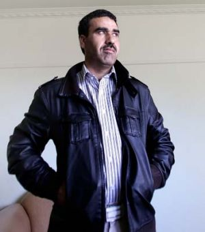 Teacher Muhammad Noor fled the Taliban after being shot.