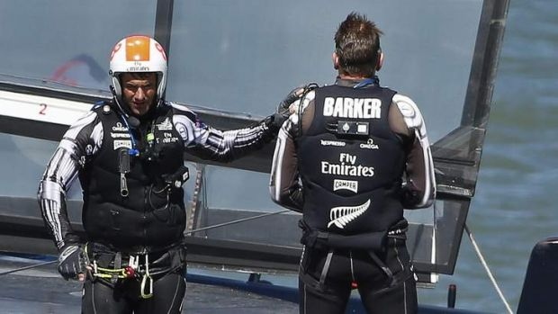 Emirates Team New Zealand's Jeremy Lomas (L) pats skipper Dean Barker on the shoulder after losing Race 17 of the 34th ...