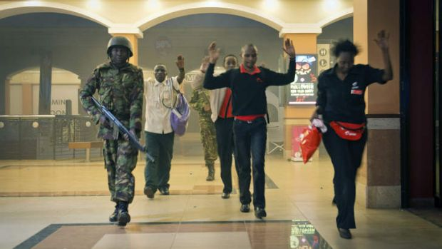 Civilians leave the mall on Saturday.