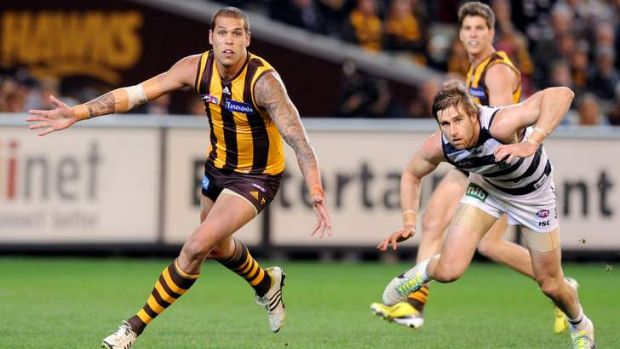 Geelong's Tom Lonergan does his best to contain Franklin during this year's preliminary final.