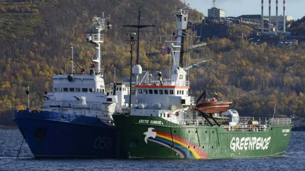 """Greenpeace ship """"Arctic Sunrise"""" is seen anchored outside the Arctic port city of Murmansk September 24, 2013."""