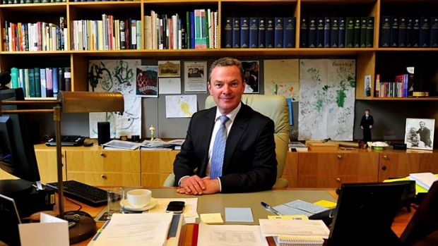 Feet under the desk: Education Minister Christopher Pyne, in his Parliament House office on Friday, will take a hands-on ...