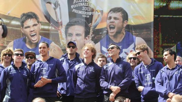 Happy to be here: Dockers players are the centre of attention at Friday's grand final festivities in the city.