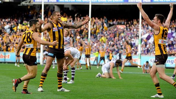 Hawthorn's Paul Puopolo, Lance Franklin and Jack Gunston celebrate on the siren.