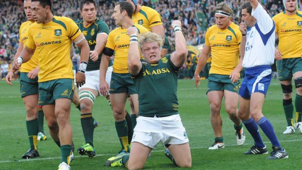 Unremarkable: Adriaan Strauss of the Springboks celebrates scoring a try against the Wallabies.