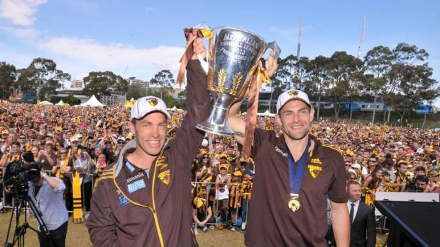 Hawthorn coach Alistair Clarkson and captain Luke Hodge with the premiership cup at Glenferrie oval.
