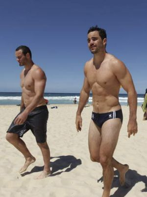 Focused on the final: The Sydney Roosters during a recovery session at Bondi Beach on Sunday morning.