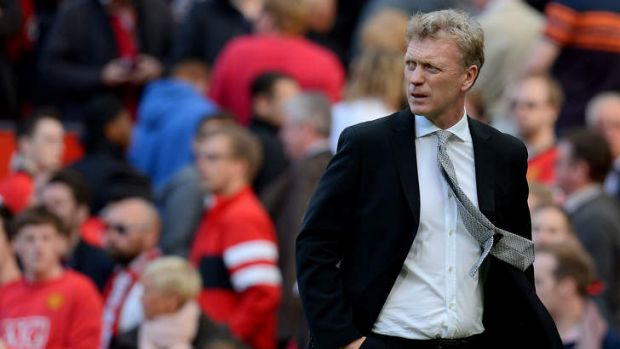 Troubling times: United manager David Moyes heads for the sheds after his side lost to West Brom at Old Trafford on Saturday.