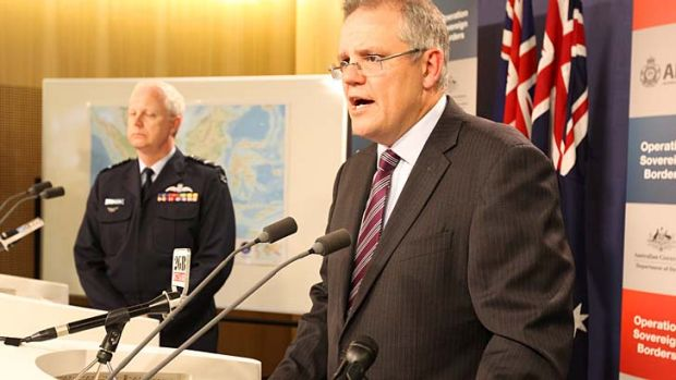 Immigration Minister Scott Morrison and Operation Sovereign Borders acting commander, Air Marshal Mark Binskin, attend ...