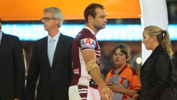 Still scarred: Brett Stewart walks away from David Gallop after Manly's win in the 2011 grand final.