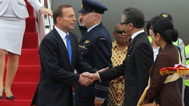 Friendly face: Tony Abbott is greeted by Foreign Affairs Minister Marty Natalegawa on his arrival in Jakarta.