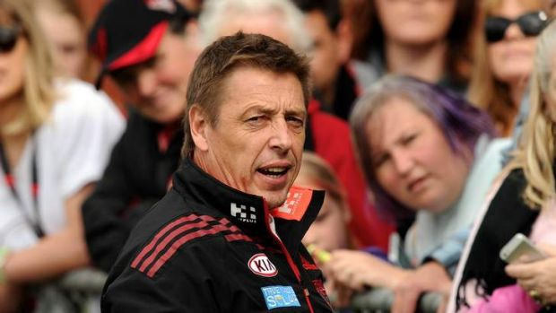 Essendon's Mark Thompson with fans at training.