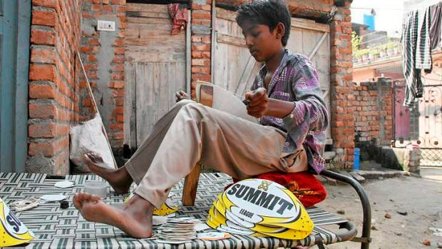 Pittance: Ramandeep, 13, earns about $1.20 a day stitching Summit balls bound for sale in Australia.