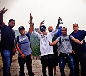 Justin Bieber celebrates with his entourage as they traverse the Great Wall of China.