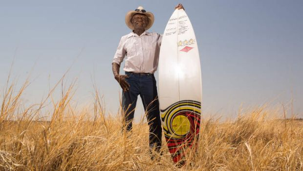 Board ructions: Jimmy Wavehill with the Recognise campaign surfboard at Wave Hill station.