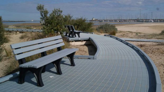 Bottom line:  Benches and boardwalk made from recovered plastics.