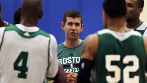 New leader: Boston Celtics head coach Brad Stevens talks with his players during their NBA basketball training camp.