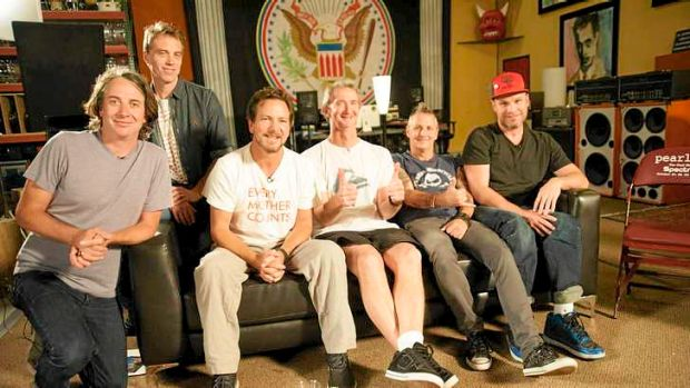 Aussie surfer Mark Richards (giving the thumbs up) with Pearl Jam.