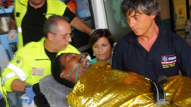 Survived catastrophe: A man is brought into Civico hospital in Sicilian capital Palermo, after being rescued from the ...