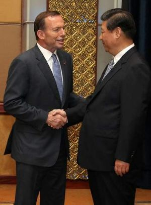 Prime Minister Tony Abbott meets Chinese President Xi Jinping.