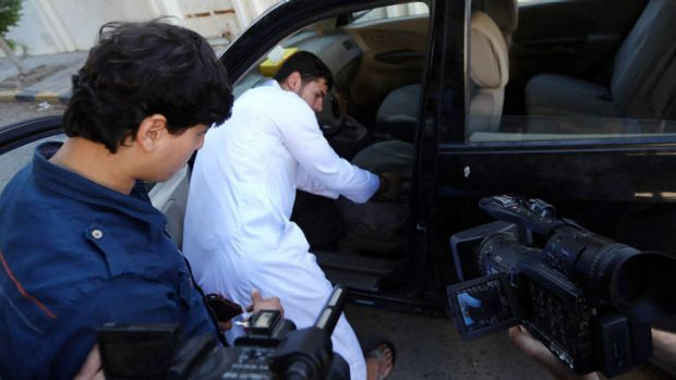 Abdullah al-Raghie (R) and Abdul Moheman al-Raghie (L), the sons of al-Qaeda suspect Abu Anas al-Libi, show the car from ...