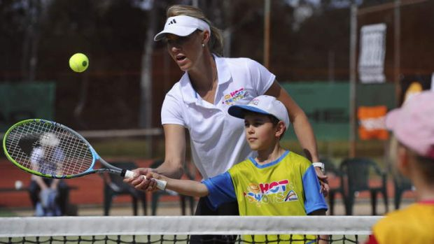 Lachlan Hewatt at his coaching clinic with Alicia Molik.