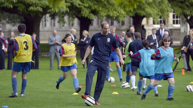 Prince William trains with members of the royal household in the grounds in the grounds of Buckingham Palace.