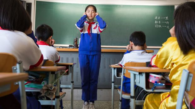 Primary school students at Jingshan School, one of Beijing's most elite schools, do exercises to help relax their eyes.