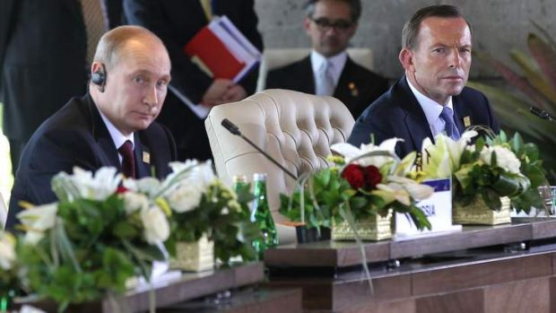 President Vladimir Putin and Prime Minister Tony Abbott during the APEC Economic Leaders' Meeting in Bali.