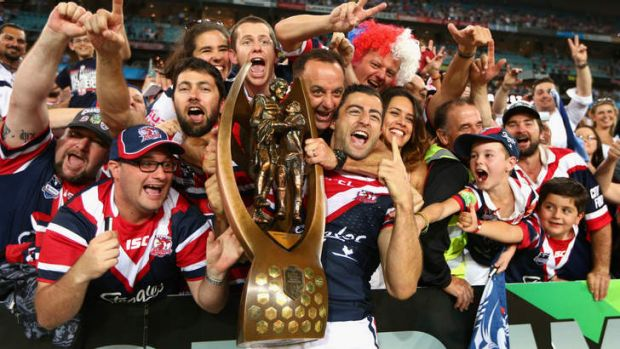 Uncertain future:  Roosters captain Anthony Minichiello celebrates with fans after winning the grand final on Sunday.