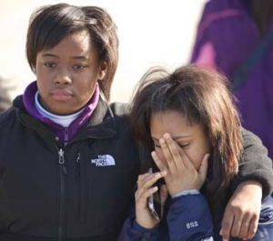 Mourners farewell a young victim, shot dead in Chicago.