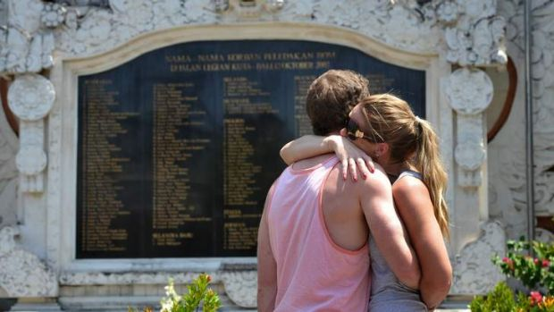Victims of terror comfort each other in front of the Bali Memorial in Kuta, Bali.