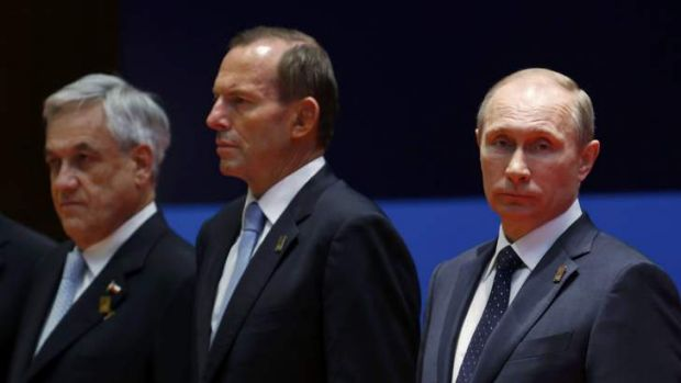 """Of utmost importance to all of us"": Vladimir Putin (right), with Tony Abbott and Chile's President Sebastian Pinera at ..."