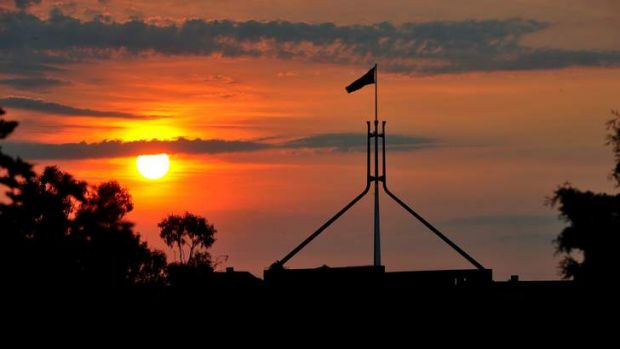 The sun sets over Parliament House.