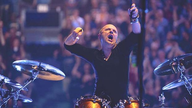 Enter soundman: Drummer Lars Ulrich goes tubthumping in the round at larger than life size in Metallica's concert ...