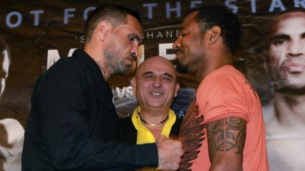 Ready to rumble: Anthony Mundine and Shane Mosley square up to each other on Wednesday.