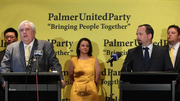 Clive Palmer from Palmer United Party with Senators-elect Ricky Muir (right) and behind from left Zhenya Wang (WA), ...
