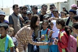 Helping hand … Princess Mary talks to children during a visit to a refugee camp in Jordan in August.