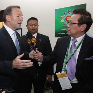 Prime Minister Tony Abbott speaks with an Australian-based journalist who was not allowed to his press conference during ...