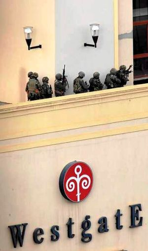 Kenya Defence Forces soldiers comb the rooftop of the Westgate shopping mall during the Nairobi siege.