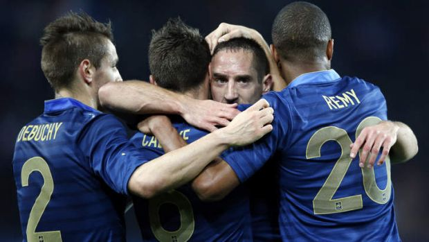 Plenty to celebrate: France's Franck Ribery and his teammates after scoring.