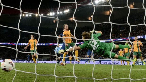 On target: France's forward Olivier Giroud (second left) scores past Australia's goalkeeper Mitchell Langerak.