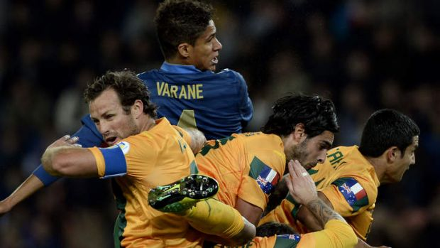Outplayed: The Socceroos were outplayed all over the pitch against the French.