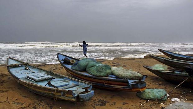 Storm: A girl plays by the Bay of Bengal.