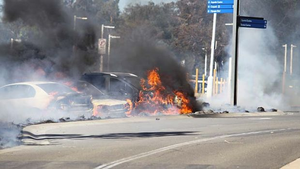 Explosions: A fire moves from vehicle to vehicle.