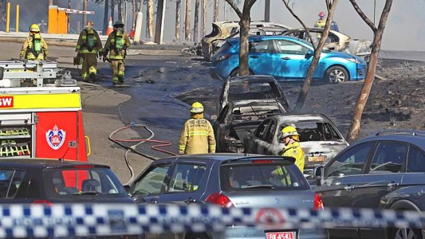 Aftermath: Burnt out cars after the Olympic Park fire.