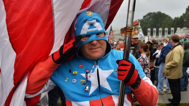 """A protester dressed as comic book super hero """"Captain America"""" joins veterans during a demonstration against the ..."""