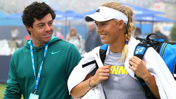 Rory McIlroy and Caroline Wozniacki on the practice court at the AEGON International tennis tournament in Eastbourne in June.