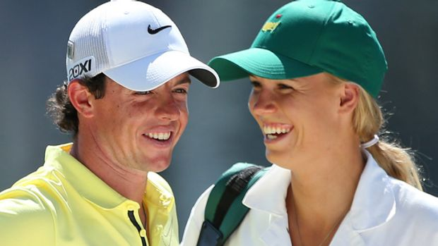 Wozniacki caddying for McIlroy during the Par 3 Contest prior to the start of the 2013 Masters Tournament.