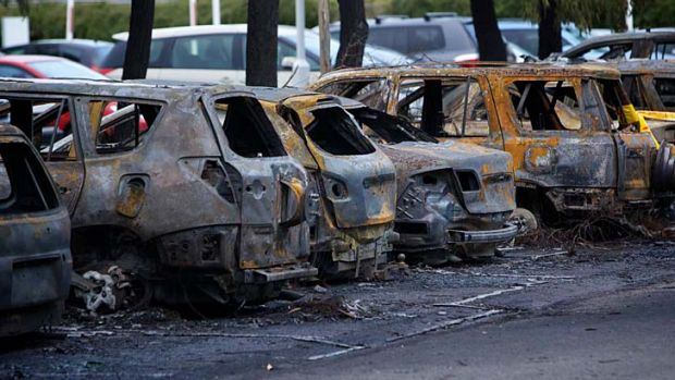 Burnt vehicles at Homebush Aquatic Centre.